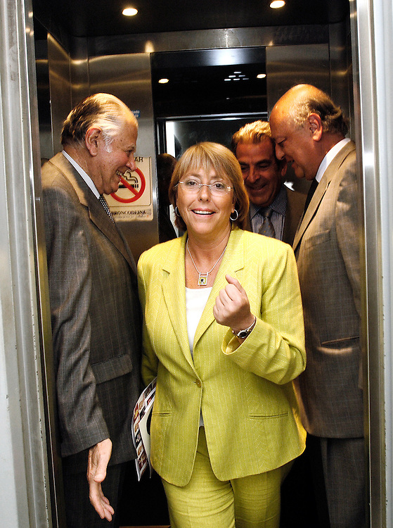 Santiago,Chile  03 January 2006<br /> Chilean presidential candidate Michelle Bachelet of the Socialist Party, former Chilean president Patricio Aylwin and former Chilean president Eduardo Frei come out of an elevator after a rally inside Chile's University. <br /> Photo: Ezequiel Scagnetti