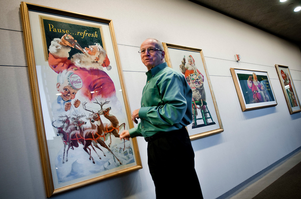 Philip F. Mooney, historian at The Coca-Cola Company shows Haddon Sundblom's original paintings of the Coca-Cola Santa Claus he created for advertisments meant to make people drink more Coca-Cola in the winter. Sundblom's image of Santa quickly became the standard for renditions of Santa Claus worldwide.