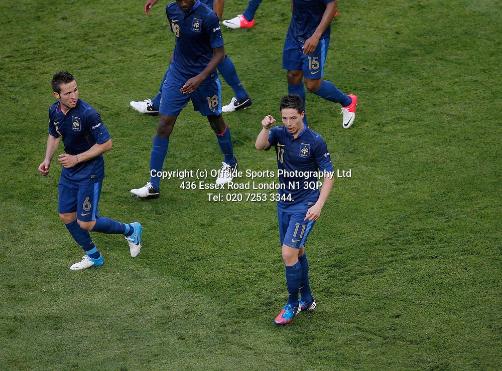 11/06/2012 European football championships. France v England.<br /> Samir Nasri points an accusing finger towards the England bench after his equalising goal.<br /> Photo: Mark Leech.