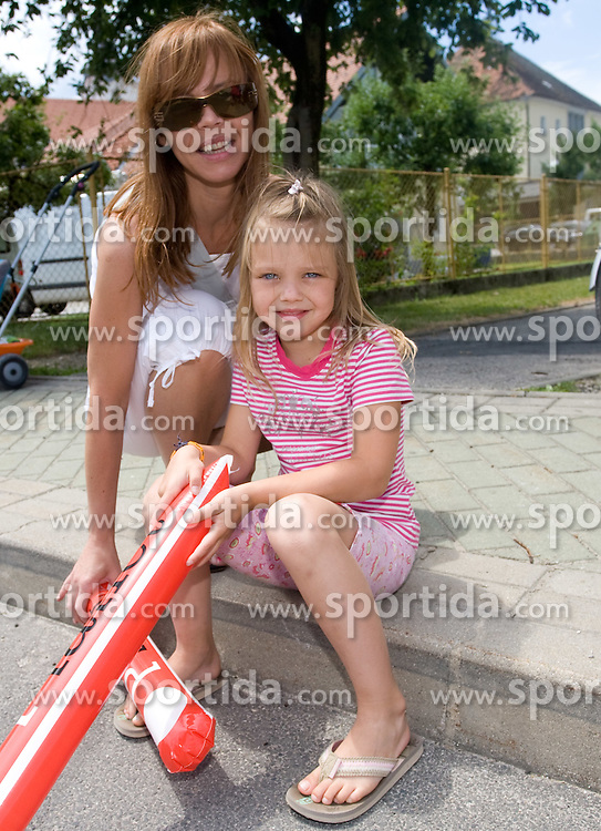 Mother with daughter after start in Sentjernej of the 4th stage of Tour de Slovenie 2009 from Sentjernej to Novo mesto, 153 km, on June 21 2009, Slovenia. (Photo by Vid Ponikvar / Sportida)