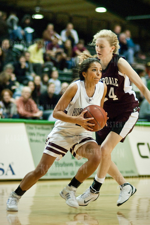 January 9, 2009 - Bronx, NY : Horace Mann hosted its annual Buzzell Games over the weekend at Manhattan College's Drady Gymnasium.  The event featured a doubleheader between the hilltop rival Lions and the Riverdale Country School Falcons. Horace Mann guard McKenzie Foster, left, drives past Riverdale's Rachel Copulsky during the Lions' 41-29 win over Riverdale.