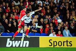 Wales Goalkeeper, Lewis Price (Crystal Palace)\ battles for the high ball with Scotland's Daniel Fox (Southampton) - Photo mandatory by-line: Joe Meredith/JMP  - Tel: Mobile:07966 386802 12/10/2012 - Wales v Scotland - SPORT - FOOTBALL - World Cup Qualifier -  Cardiff   - Cardiff City Stadium -