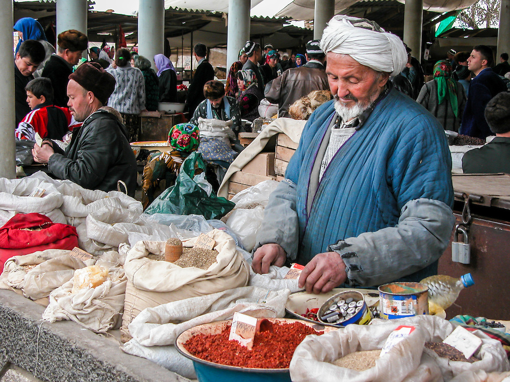 Portrait of an old Tajik man selling herbs and spices in a market in western Tajikistan