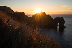 © Licensed to London News Pictures. 05/11/2016. Lulworth, UK.  Sunrise at Durdle Door on the Jurassic Coast in Dorset this morning, 5th November 2016.  Photo credit: Rob Arnold/LNP