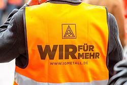 """03.05.2016, Clemensgalerien, Muehlenplatz, Solingen, GER, Warnstreik IG Metall, im Bild Logo und Schriftzug """"Wir fuer mehr"""" auf dem Ruecken einer Weste // during a Emptive strike of the trade union """"IG Metall"""" at the Clemensgalerien, Muehlenplatz in Solingen, Germany on 2016/05/03. EXPA Pictures © 2016, PhotoCredit: EXPA/ Eibner-Pressefoto/ Deutzmann<br /> <br /> *****ATTENTION - OUT of GER*****"""