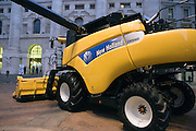New Holland tractor is displayed in front of Stock Eschange building in Milan, Jan 3. 2011. Today is the first quotation day of Fiat's two new divisions, Fiat Industrial spa and Fiat spa. © Carlo Cerchioli