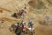 The sixth picture of the sequence of a crash at the ATVA MX National Feb 4-5, 2006 at Glen Helen. The sixth picture displays the after effects of the pile up. Jerimiah Jones (#2)finds his bike as Wimmer and Nelson are all hung up one. Spader and Cain avoid the pile.