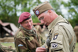 Brothers in arms, a Paratoorper from the British 6th Airborne Division and technical sergeant of the American 101st airborne division take part in living history displays at the 7 Lake Country Park 1940's weekend<br />
