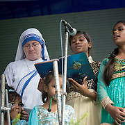 KOLKATA, INDIA 4 SEPT: Images from the Canonization of Saint Mother Teresa at the Motherhouse in Calcutta, India. A small group of children sang songs for the lead up event to the Canonization of Saint Mother Teresa.<br /> PICTURED: Sr. Joan of Arc M.C. with the singing group from Nirmala Shishu Bhavan (Home for Children) in Calcutta.