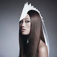 Asian female model in profile wearing long white headdress