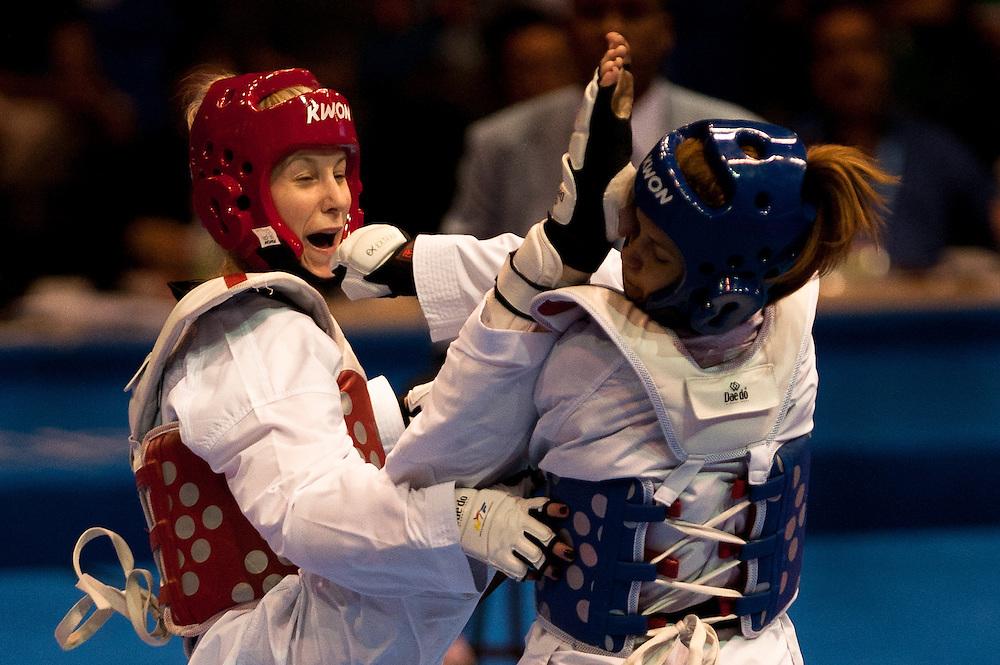 Oct. 15, 2011 - Guadalajara, Mexico - Ivett Conda of Canada defeats Canseco Diez of Peru during Taekwondo competitions at the 2011 Pan American Games in Guadalajara, held from October 15 at the CODE II Gymnasium in Guadalajara. .©Benjamin B Morris