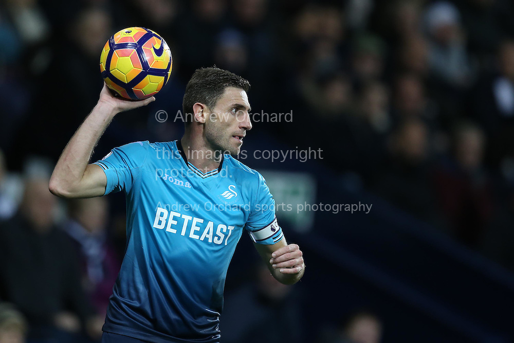 Angel Rangel of Swansea city looks on as he prepares to take a throw-in. Premier league match, West Bromwich Albion v Swansea city at the Hawthorns stadium in West Bromwich, Midlands on Wednesday 14th December 2016. pic by Andrew Orchard, Andrew Orchard sports photography.
