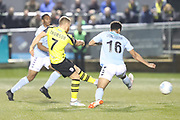 Harrogate Town midfielder Lloyd Kerry (17) scores his team's second goal during the Vanarama National League match between FC Halifax Town and Dover Athletic at the Shay, Halifax, United Kingdom on 17 November 2018.