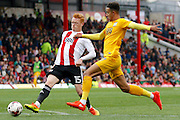 Preston North End forward Callum Robinson (37) losses out to Brentford midfielder Ryan Woods (15) during the EFL Sky Bet Championship match between Brentford and Preston North End at Griffin Park, London, England on 17 September 2016. Photo by Andy Walter.