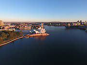 The Sydney Opera House & Harbour Bridge bathed in early morning sunlight