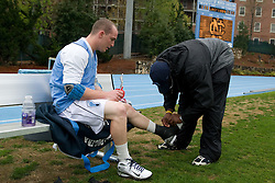 05 April 2008: North Carolina Tar Heels midfielder Nick Tintle (23) and athletic trainer Geoffrey Staton before playing the Virginia Cavaliers in Chapel Hill, NC.