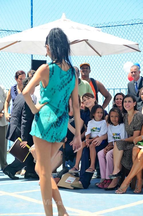 French first lady Carla Bruni visits Brazilian NGO for children care Criança Esperança, and assists to a fashion show of Moda Fusion , a French-Brazilian NGO, in the favela Pavao-Pavaozinho in Copacabana. On her right, Nadine Gonzales, the French creator of Moda Fusion. On her left, Adriana Ancelmo, wife of Rio State governor, Sergio Cabral...Carla Bruni Sarkozy visite l'ONG brésilienne Criança Esperança, aidant les enfants défavorisés, dans la favela Pavao-Pavaozinho, à Copacabana. Elle assiste ensuite à un défilé de mode de l'ONG franco-brésilienne Moda Fusion. A sa droite, la directrice de Moda fusion, Nadine Gonzales. A sa gauche, Adriana Ancelmo, épouse de Sergio Cabral, le gouverneur de l'état de Rio de Janeiro.