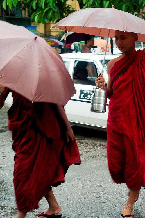 Novice monks crossing the street at Yangon