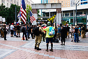 Attendees of the Freedom Rally gather at Westlake Park. Seattle, WA. August 13, 2017.
