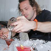 NLD/Amsterdam/20120514 - Presentatie Cointreau fles vol strikjes ontworpen door Alexis Mabille, Cointreau cocktail