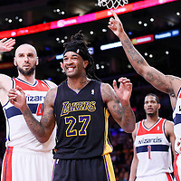 21 March 2014: Los Angeles Lakers forward Jordan Hill (27) reacts to a call next to Washington Wizards center Marcin Gortat (4) and Washington Wizards forward Trevor Booker (35) during the Washington Wizards 117-107 victory over the Los Angeles Lakers at the Staples Center, Los Angeles, California, USA.