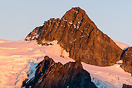 The Summit Pyramid of Mount Shuksan at sunset in North Cascades National Park, Washington State, USA.  The glacier on the left side is the Hanging Glacier and Upper Curtis Glacier is on the right.  Photographed from Huntoon Point along Kulshan Ridge in the Mount Baker-Snoqualmie National Forest.