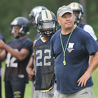 Members of the North Brunswick High School football team practice at the school Friday August 1, 2014. (Jason A. Frizzelle)