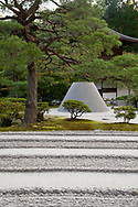 Pine trees around the raked sand garden and the conical sand dome at the Ginkaku-ji Pure Land Garden, Kyoto, Japan