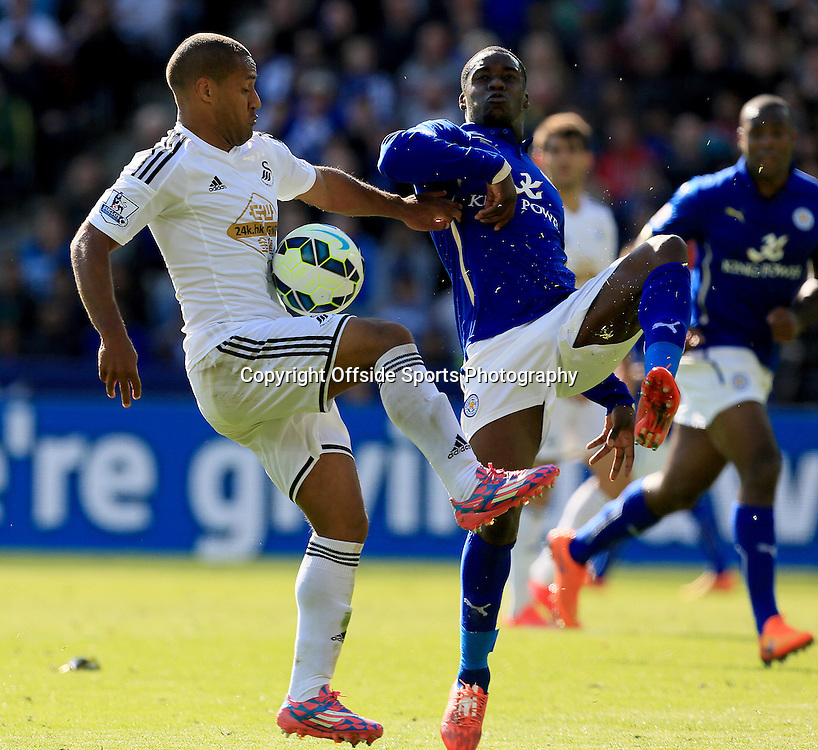 18th April 2015 - Barclays Premier League - Leicester City v Swansea - Wayne Routledge of Swansea City battles with Jeff Schlupp of Leicester City - Photo: Paul Roberts / Offside.