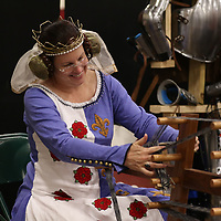 Lea Johnson works an Inkle Loom Saturday during the Tupelo Comic Con