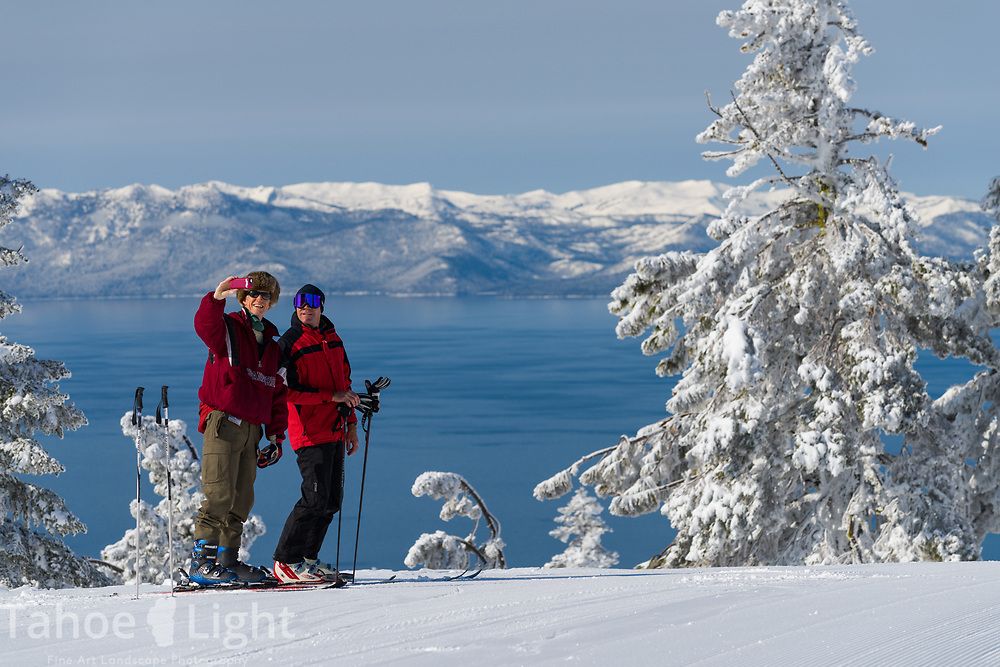 Skiers take a selfie with Lake Tahoe as viewed from Diamond Peak ski resort in Incline Village after a snow storm.