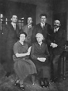 Marie Curie (1867-1934) Polish-born French physicist, with her daughter Irene Joliot-Curie (1897-1956) with members of the Institute of Radium, Paris. On the right is their co-worker Andre Debierne