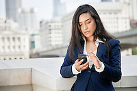 Young Indian businesswoman using smart phone