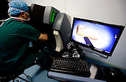 """WUHAN, CHINA - FEBRUARY 07: (CHINA OUT) <br /> <br /> Surgical Robot """"Da Vinci"""" Put Into Operation<br /> <br /> Doctors perform a surgery with Da Vinci surgical robot at Wuhan Tongji Hospital on February 7, 2015 in Wuhan, Hubei Province of China. According to local media, there are more than 30 Da Vinci surgical robots in mainland China. <br /> ©Exclusivepix Media"""