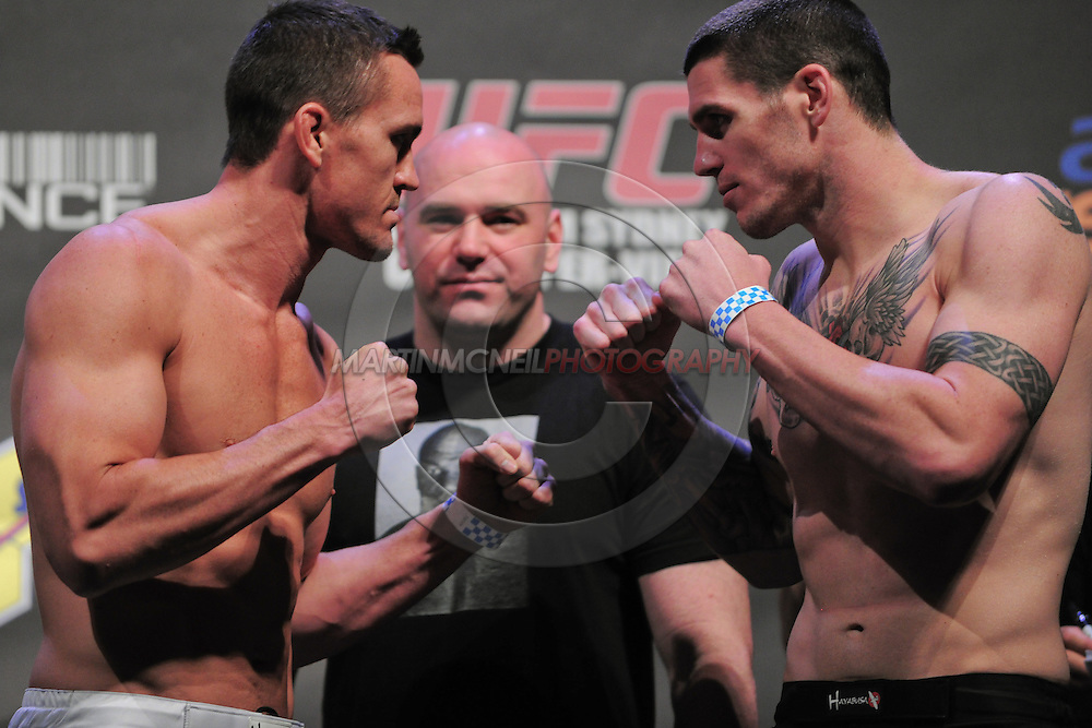 "SYDNEY, AUSTRALIA, FEBRUARY 26, 2011: Kyle Noke (left) faces off against opponent Chris Camozzi during the weigh-in for ""UFC 127: Penn vs. Fitch"" inside Acer Arena in Sydney, Australia on February 26, 2011"