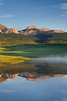 Rocky Mountain Front Range reflected in pond near Choteau Montana