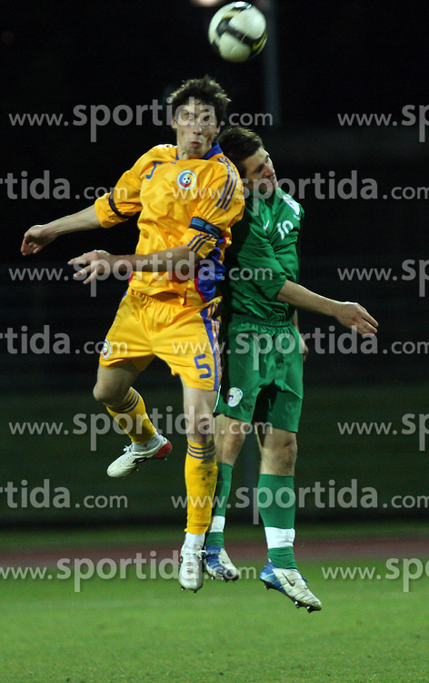 Valerica Gaman of Romania and Luka Majcen (19)  of Slovenia jumping for the ball during Friendly match between U-21 National teams of Slovenia and Romania, on February 11, 2009, in Nova Gorica, Slovenia. (Photo by Vid Ponikvar / Sportida)