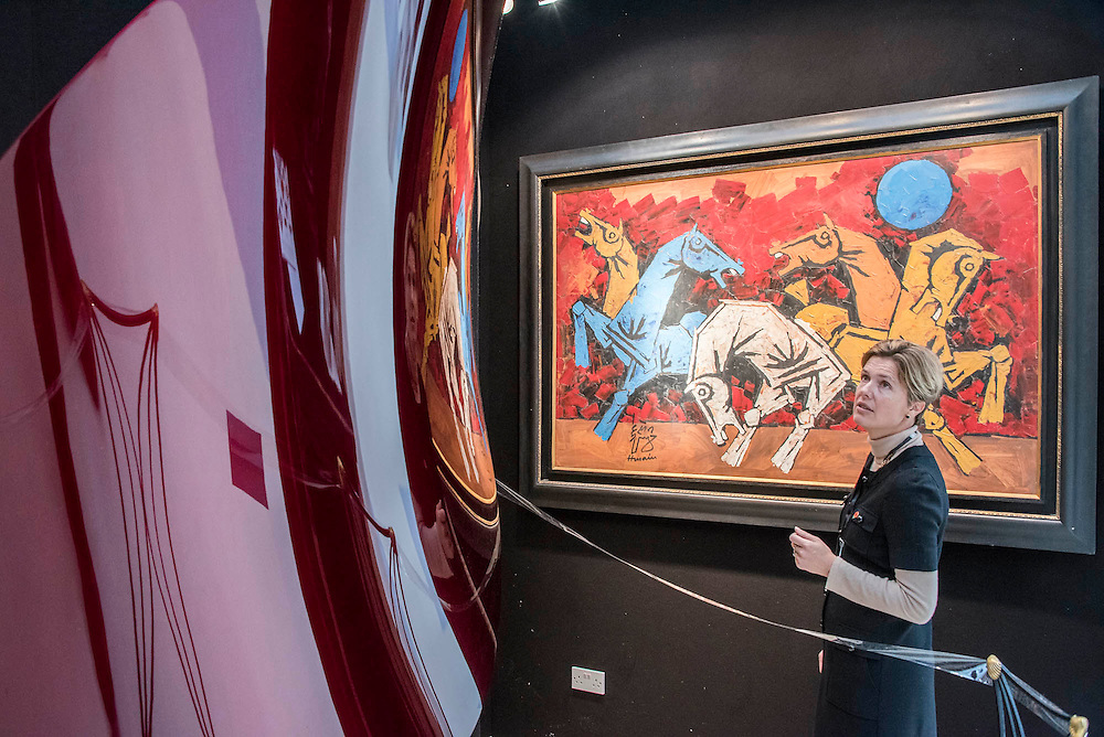A reflective work by Anish Kapoor worth £800k approx on the Tanya Baxter stand - Winter Olympia Art & Antiques Fair- in its 25th year the fair plays host to 22,000 visitors who come to see over 30,000 pieces for sale from the 120 hand-picked dealers valued frpom £100-£1m.  The fair runs from 2-8 November 2015, opening with the Collector's Preview Reception on 2 November at 5pm..