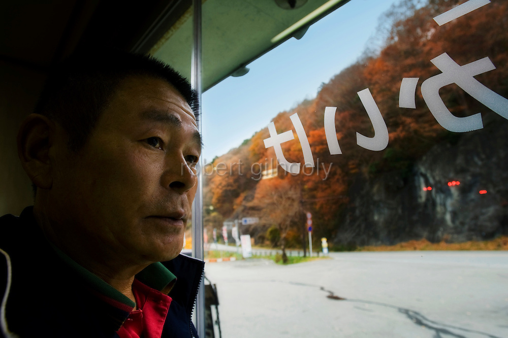 Hideo Watanabe, 64, who has prevented hundreds of people from committing suicide over the past three and a half decades, poses for a photo at his store, which is located on the edge of Aokigahara Jukai, better known as the Mt. Fuji suicide forest, in Yamanashi Prefecture, west of Tokyo, Japan on 19 Nov. 2009. .