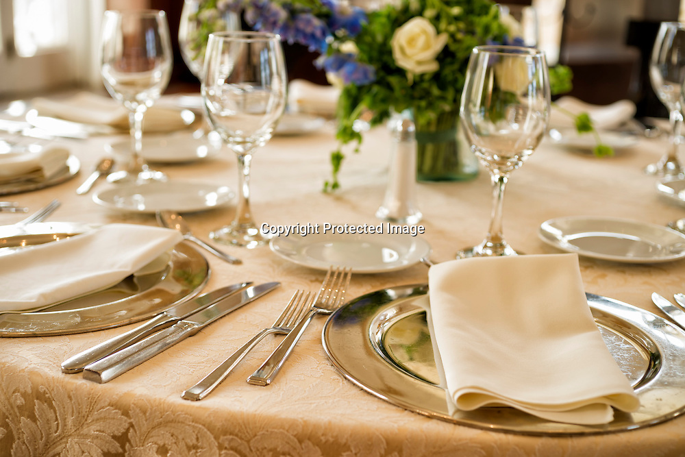 Place setting detail at a banquet table.