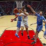 05 December 2018: San Diego State Aztecs guard Jordan Schakel (20) knifes through San Diego Toreros guard's Isaiah Wright (22) and  Finn Sullivan (23) for a basket in the second half. The Aztecs lost to the Toreros 73-61 at Viejas Arena.