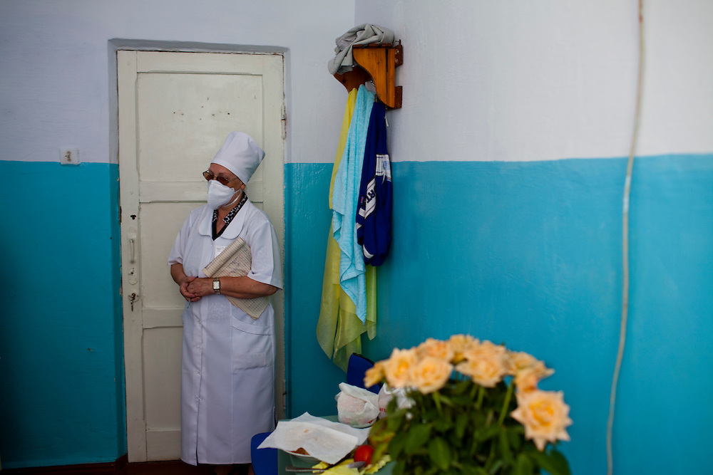 Aglia Craciu, a nurse at the TB hospital in Balti, stands in a patient's room during a check up