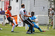 Luton Town Zane Banton shoots at goal and Peacehaven Allied Secko makes the save during the Pre-Season Friendly match between Peacehaven & Telscombe and Luton Town at the Peacehaven Football Club, Peacehaven, United Kingdom on 18 July 2015. Photo by Phil Duncan.