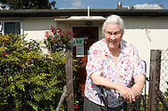 Pamela Clifton in front of her prefab at the Excalibur estate in Catford, South London. Pamela has been living in her prefab for 40 years and is fighting to save it as the Lewisham Council want to pull the prefabs down. Thousands of post-war prefabs are still being lived in and cherished by their tenants or owners all over the UK.