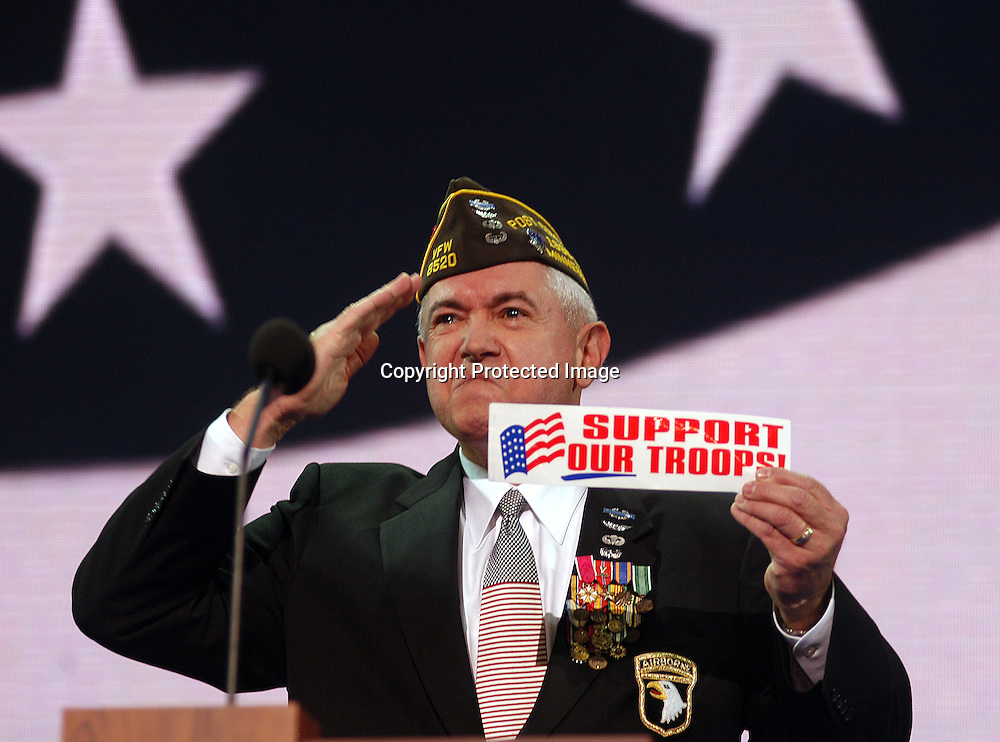 Lt. Col. Joseph Repya ( Ret.) of Eagan MN gives the pledge of Allegiance afterwards sulutes while holding a sign showing Support our troops during the opening session of the Republican National Convention in New York City. Sandy Schaeffer/MAI Sandy Schaeffer Photography - Washington DC Photographer<br />