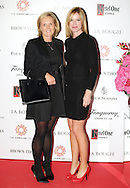 27/9/14***NO REPRO FEE*** Pictured is Pauline Cullenand Maeve Lynch as Dublin's ladies turn out for a fashionable Cocktail Evening in aid of the Caroline Foundation Pic: Marc O'Sullivan  Friday 26th September: Last night saw a slice of high-end NY style hit Dublin, arriving at The Four Seasons.  Stylish ladies turned out in force to support the event and to mark the start of Breast Cancer Awareness month. The fundraiser, which was a sell-out was the brainchild of Paula McClean a breast cancer survivor and tireless fundraiser. Combining her love of fashion and a good party, the first Cocktail Club Event was born. With a great night of style, fun and raising a lot of money for cancer research, it is no wonder it was a sell- out.  The lucky ladies were treated to a special fashion Show by Brown Thomas who show cased their designers in a salon style. The show featured a selection of key looks mirroring trends from the international runways. The mood for AW14 is easy, elegant, casual and chic. New labels to love include Jenny Packham, Valentino, Osman, Brunello Cucinelli and Moschino. Curated by the affable Michelle Curtain, the clothes were a show-stopper. In keeping with the era of the collection, the evening had a distinctive New York retro theme. Signature 'Original' cocktails from The Four Seasons, featuring Tanqueray London Dry Gin and Ketel-One with the trademark Copper Kettle serve, were the order of the day with eclectic tunes from club DJ Dom to keep the party going. All the lucky ladies went home with a luxury La Bougie Candle. The inaugural Cocktail Club in aid of the Caroline Foundation is the brainchild of Paula McClean a breast cancer survivor and tireless fundraiser. Commenting on the evening, 'Breast Cancer and the Caroline Foundation are very close to my heart and combining this with my love of fashion and a good party, we came up with the first Cocktail Club. We are looking forward to a great night of style, fun and raising a lot of money for can