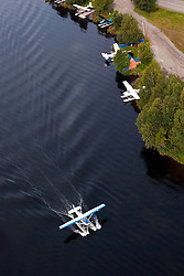 Aerial view of a floatplane landing on Lake Hood, Anchorage, Alaska, United States of America