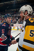 REGINA, SK - MAY 25: Josh Mahura #5 of Regina Pats shakes hands with Justin Lemcke #5 of Hamilton Bulldogs at the Brandt Centre on May 25, 2018 in Regina, Canada. (Photo by Marissa Baecker/CHL Images)