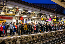 © Licensed to London News Pictures. 16/12/2019. London, UK. Queues build up by 07.30am this morning at Clapham Junction. Commuters faced queues and more delays at Clapham Junction this morning as a new National Rail winter timetable comes into effect along with the on going RMT strike on South West Rail services now in its third week. Photo credit: Alex Lentati/LNP