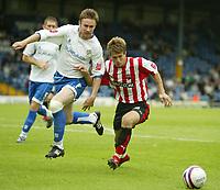 Photo: Aidan Ellis.<br /> Bury FC v Brentford. Coca Cola League 2. 01/09/2007.<br /> Brentford's Charlie Ide battles with Bury's Nicky Adams